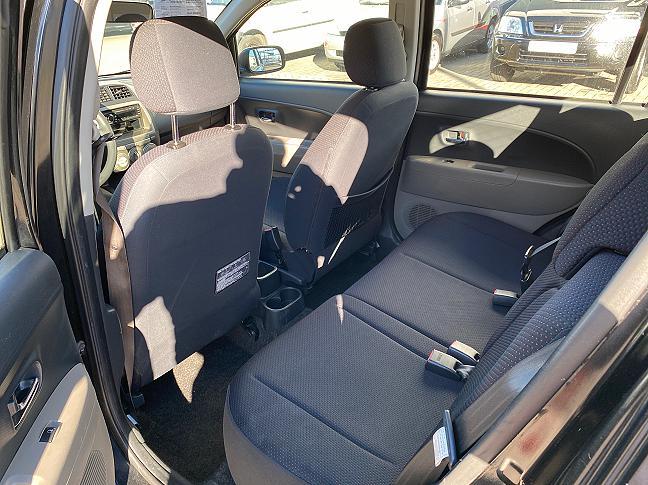 Te koop Daihatsu Sirion 2 1.3-16V Comfort Zwart occasion - Autobedrijf Den Haag